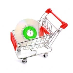 Mini CD in shopping cart isolated on white