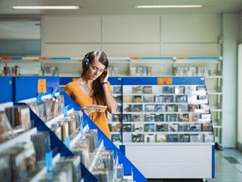 Female listening to music in a music shop
