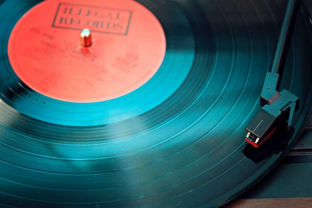 A large cut on a vinyl record can kick a needle out of its groove.