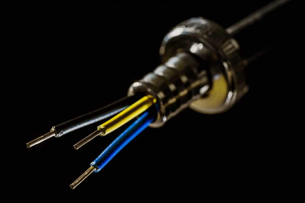 Analog processing occurs at an electrical level.