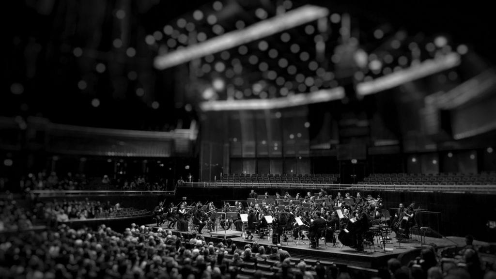 Classical music halls are designed with reverb times in mind.