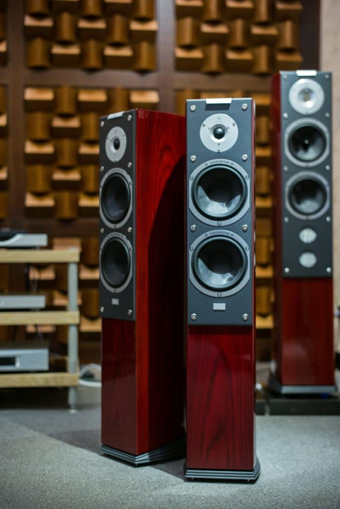 Speakers would cause a signal to be dispersed and reflected in a room.
