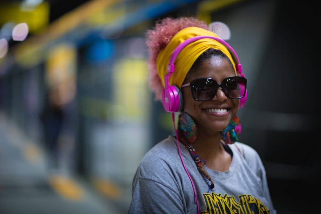Headphones allow music to be more easily perceived, as they cancel out background noise.