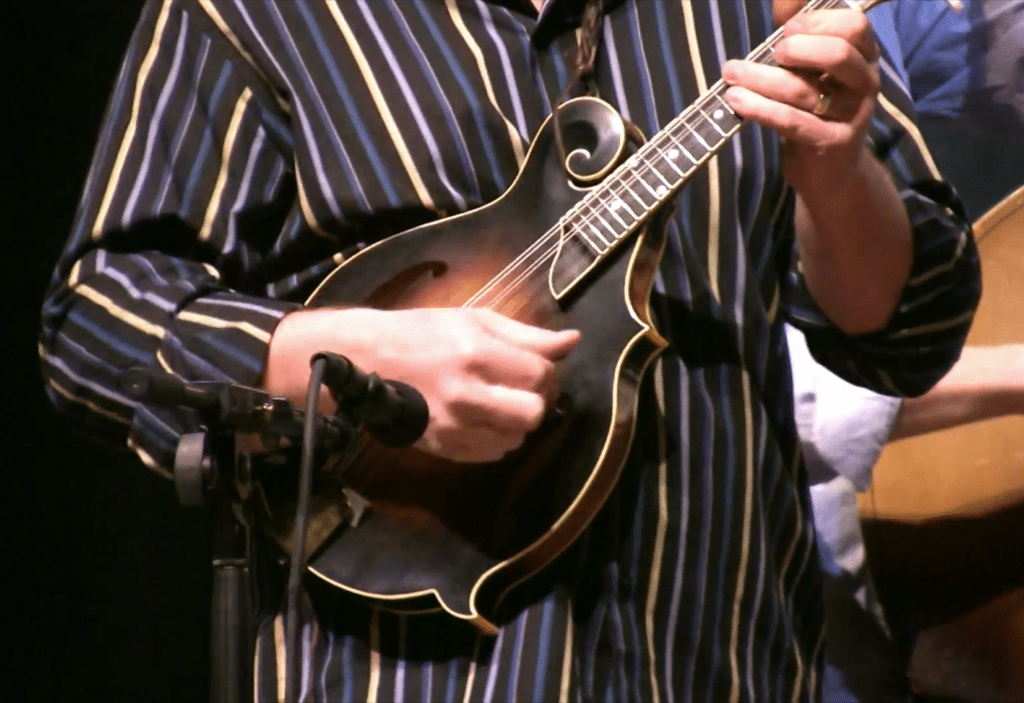 Mastering bluegrass music is a difficult balance between making an impressive sound and keeping it sounding natural.