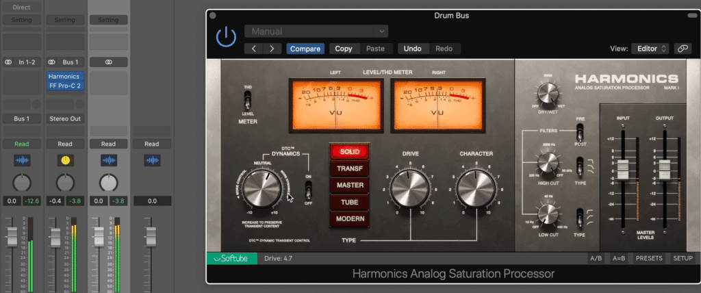Use a harmonics plugin either before or after your drum bus compression.